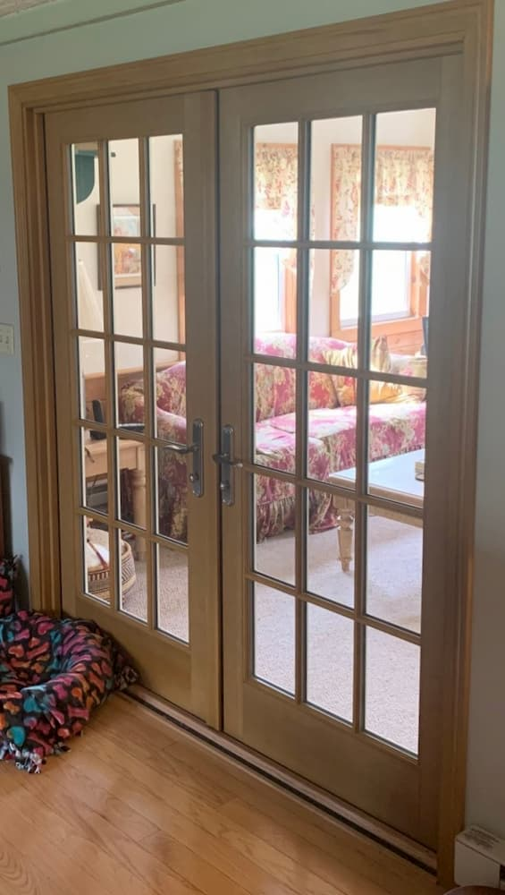 Interior view of wooden double French doors with traditional grille pattern