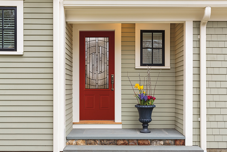 Full light storm door with beveled glass