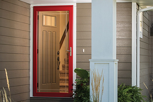 Red storm door with Prairie-style glass