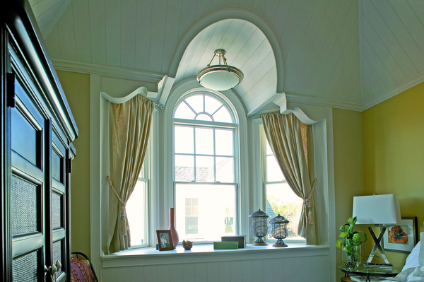 Traditional bay windows with curtains