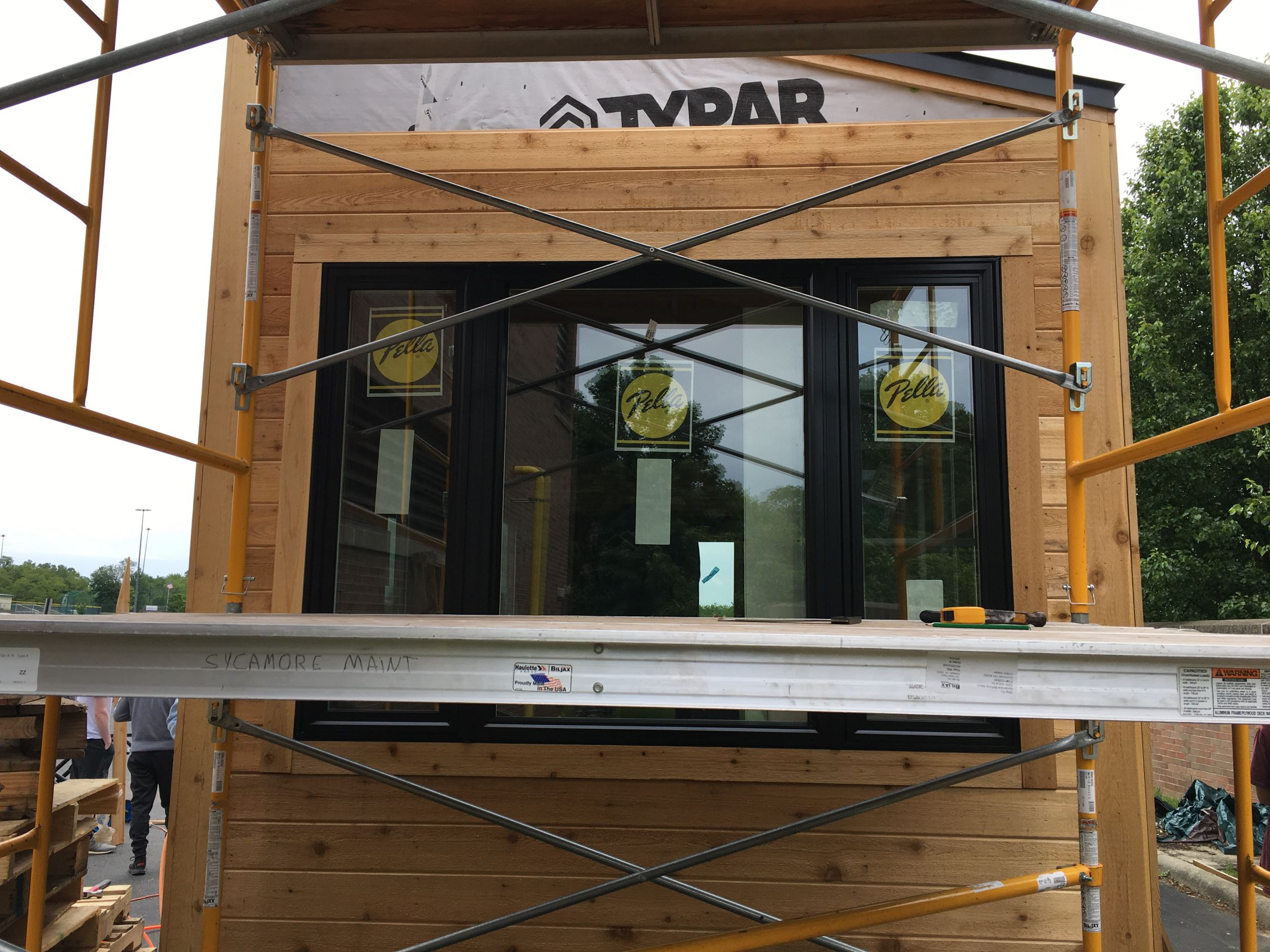 Vinyl windows with black exterior on a tiny home