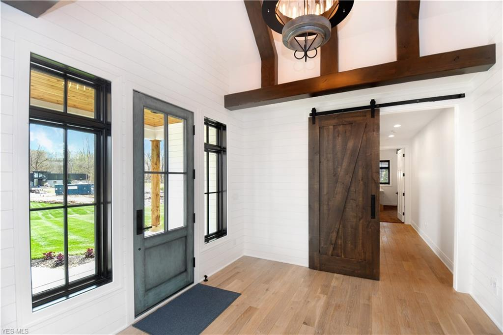 Entry with black wood windows - Chagrin Falls